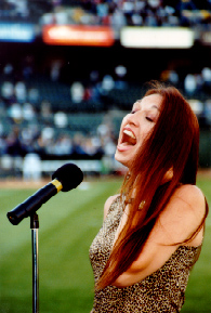 Photo: Kimberlee Sings the National Anthem at Oakland A's Game - (Please wait 10 seconds while photo loads.)